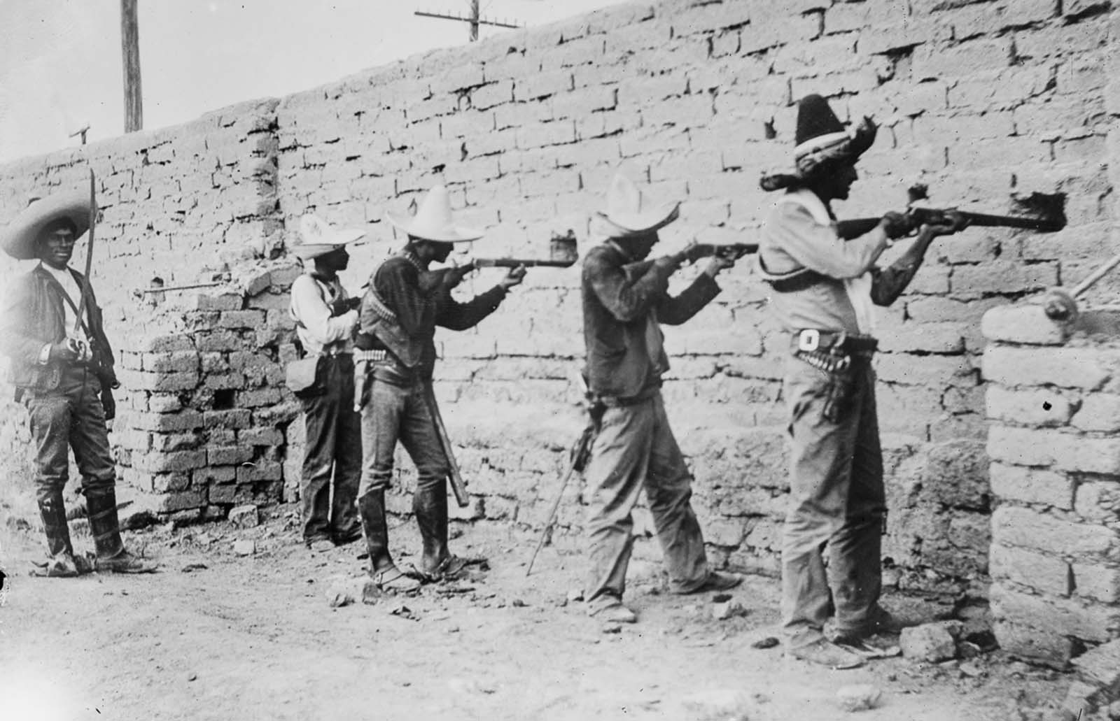 Rebels take aim from a fortified position in Ciudad Juárez.