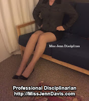 Disciplinarian with hands on her hips