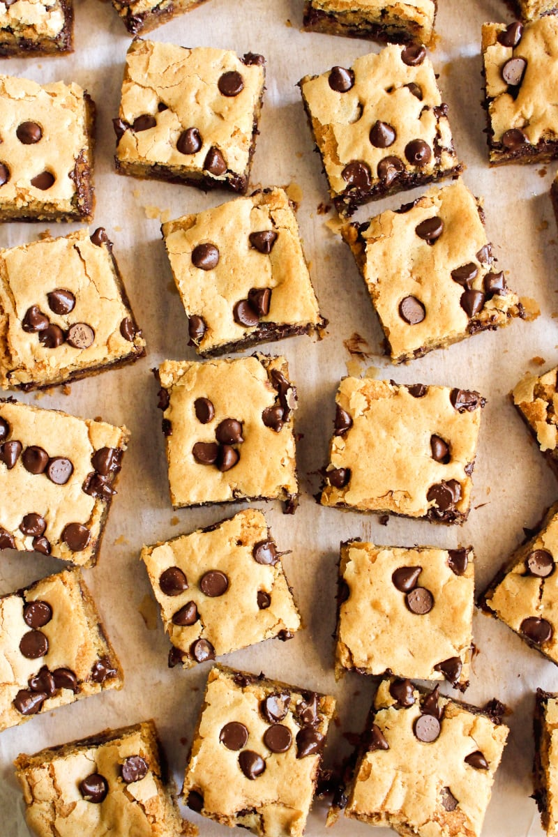 Top view of brown butter cookie bars squares on a piece of parchment paper.