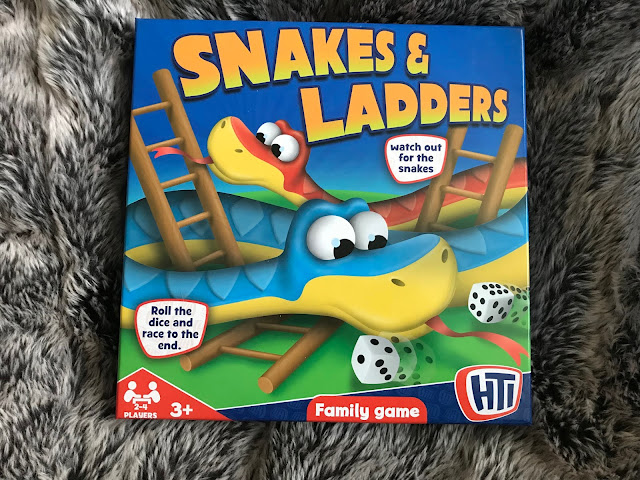 snakes and ladders board game in box