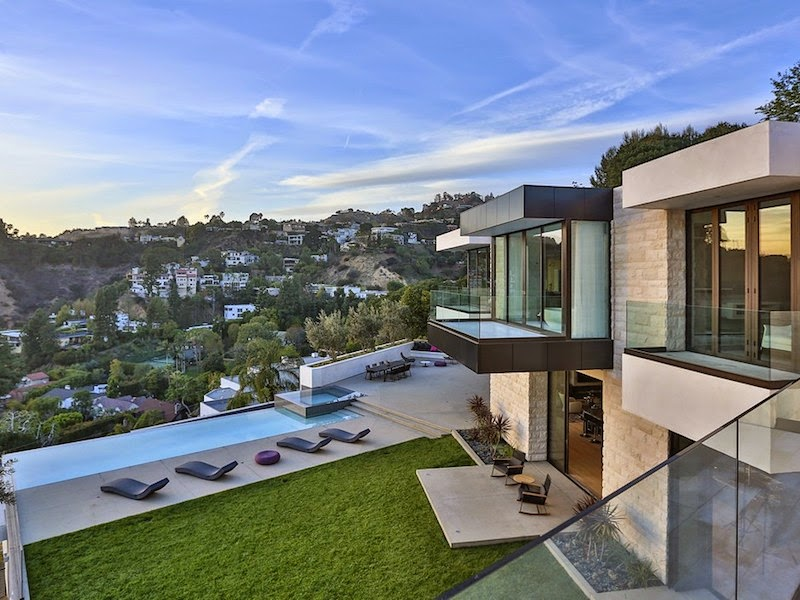 With panoramic views of the entire la basin this stunning contemporary architectural is perched on celebrity studded oriole way