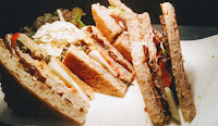 Four pieces of veg club sandwich with fries and Coleslaw food recipe