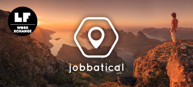 Man standing on cliff overlooking rugged mountain near the water, sunset in the background adds warm glow to the entire image, jobbatical company logo displayed in white
