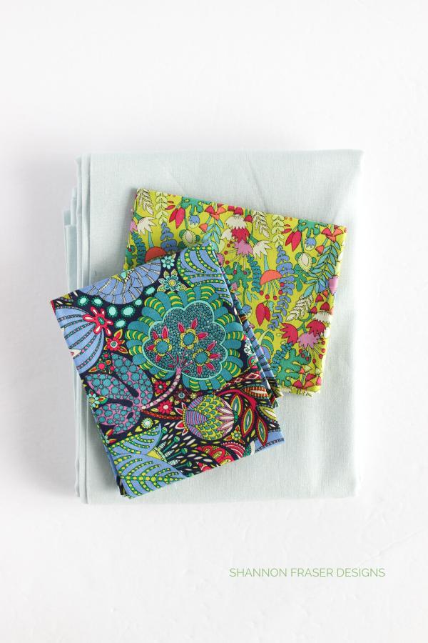Fantasy fabrics + Essex Linen | Double Chevron lumber pillow - Fantasy version | Shannon Fraser Designs #quiltedpillow #homedecor #quiltingcotton #linen