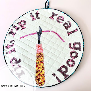 A fun wall hanging by CraftyRie but should it be turned into a clock?