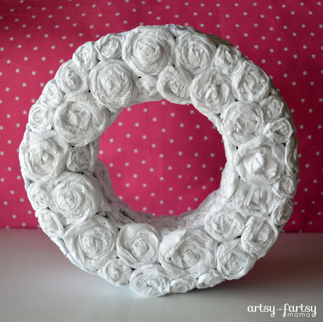 Crepe Paper Rosette Wreath at artsyfartsymama.com #wreath