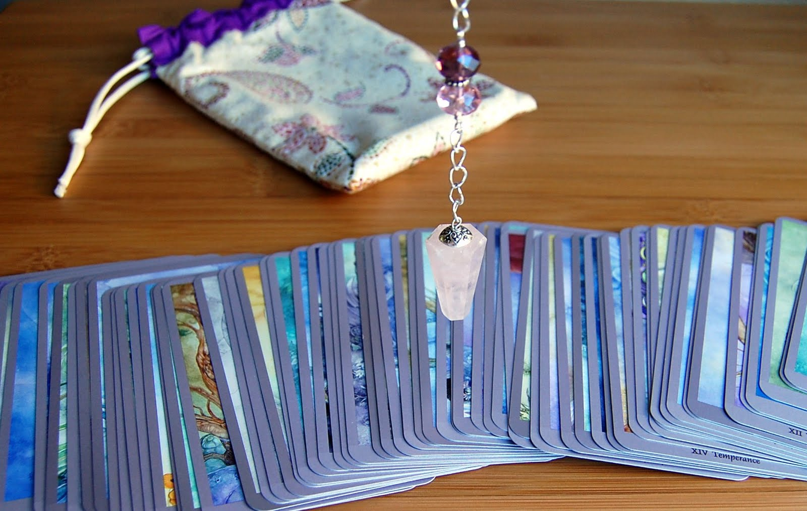 Pendulum Tip – Cleansing Your Tarot Deck | Crowning Elements