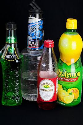 The Dirty Grinch cocktail, christmas cocktail, Dr. Seuss, Dr. Seuss cocktail, Midori, melon liqueur, lemon juice, simple syrup, grenadine