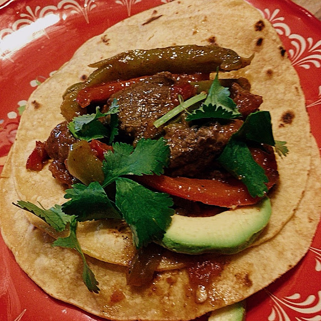 Steak Picado taco with avocado slices