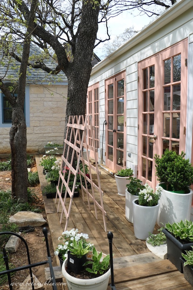Peach greenhouse new deck is made from salvaged redwood boards
