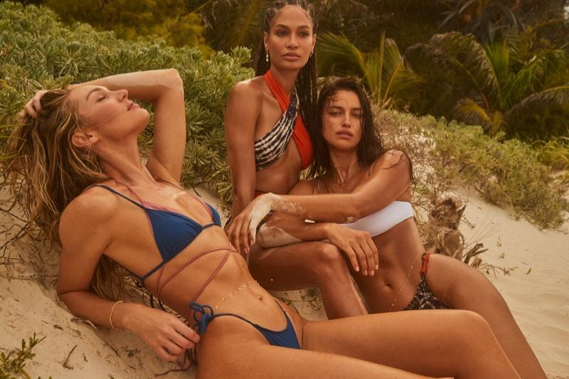 Candice Swanepoel, Joan Smalls, and Irina Shayk pose for REVOLVE x Tropic of C Swim collection. Photo: David Roemer