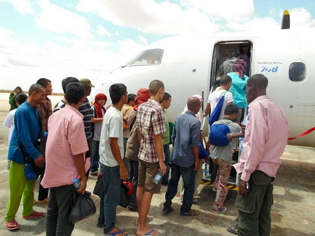 Former hostages board a plane bound for Nairobi earlier this week after they were free from captivity. ISWAN