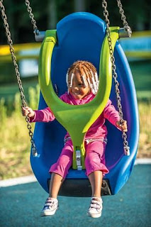Child Swinging in therapeutic swing