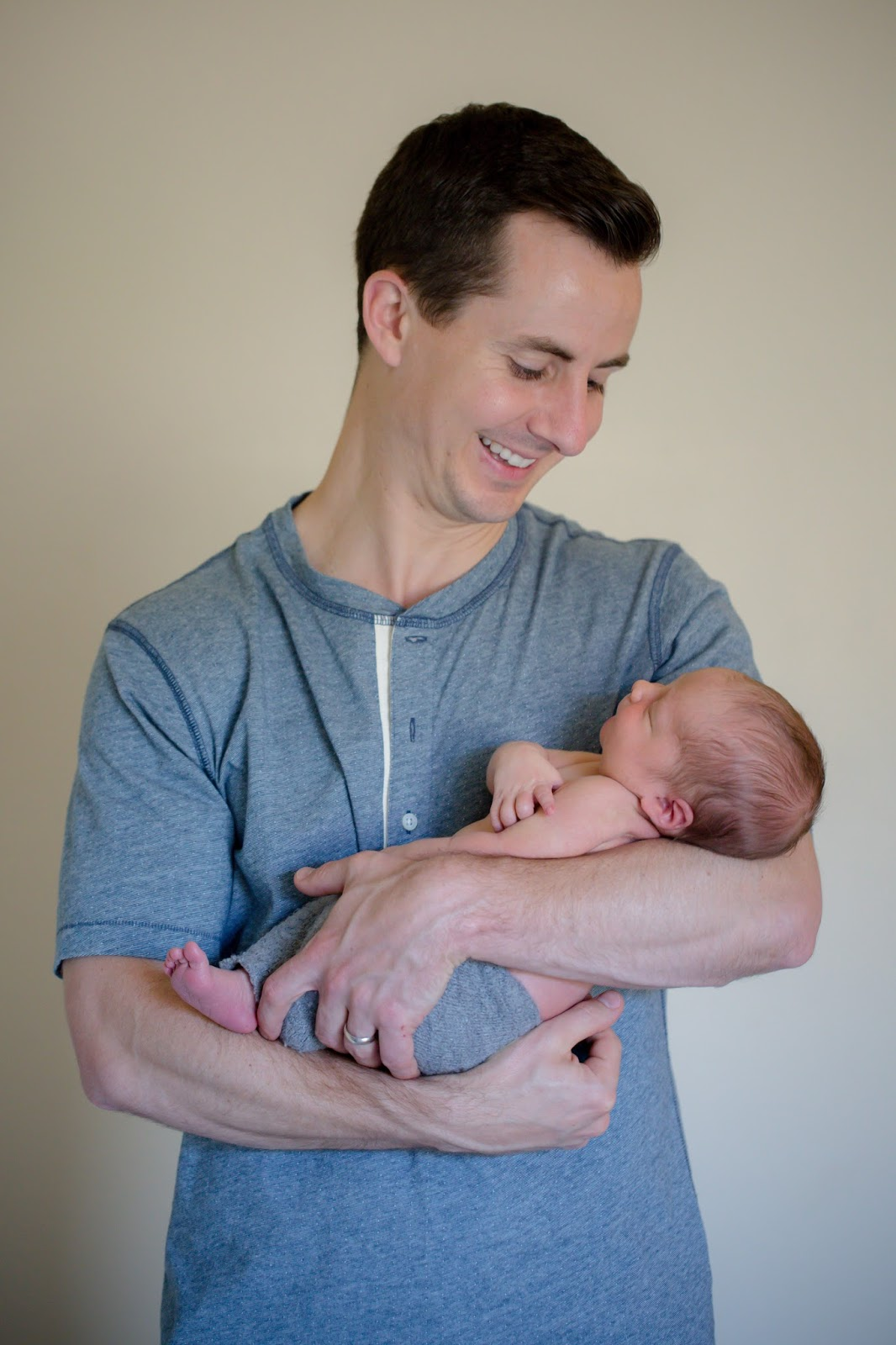 Dad and newborn baby boy photo