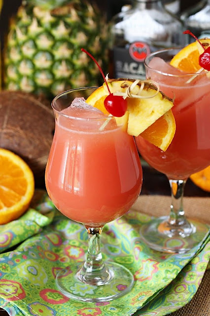 Caribbean Rum Punch In a Glass with Pineapple Wedge Garnish Image
