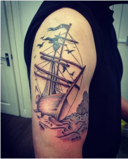 89d311c8d 47. Do not forget to add a black pirate flag and a large net in your pirate ship  tattoo design because it will make the tattoo more meaningful.