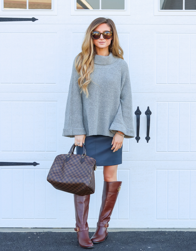 oversized sweater with faux leather skirt and tory burch boots