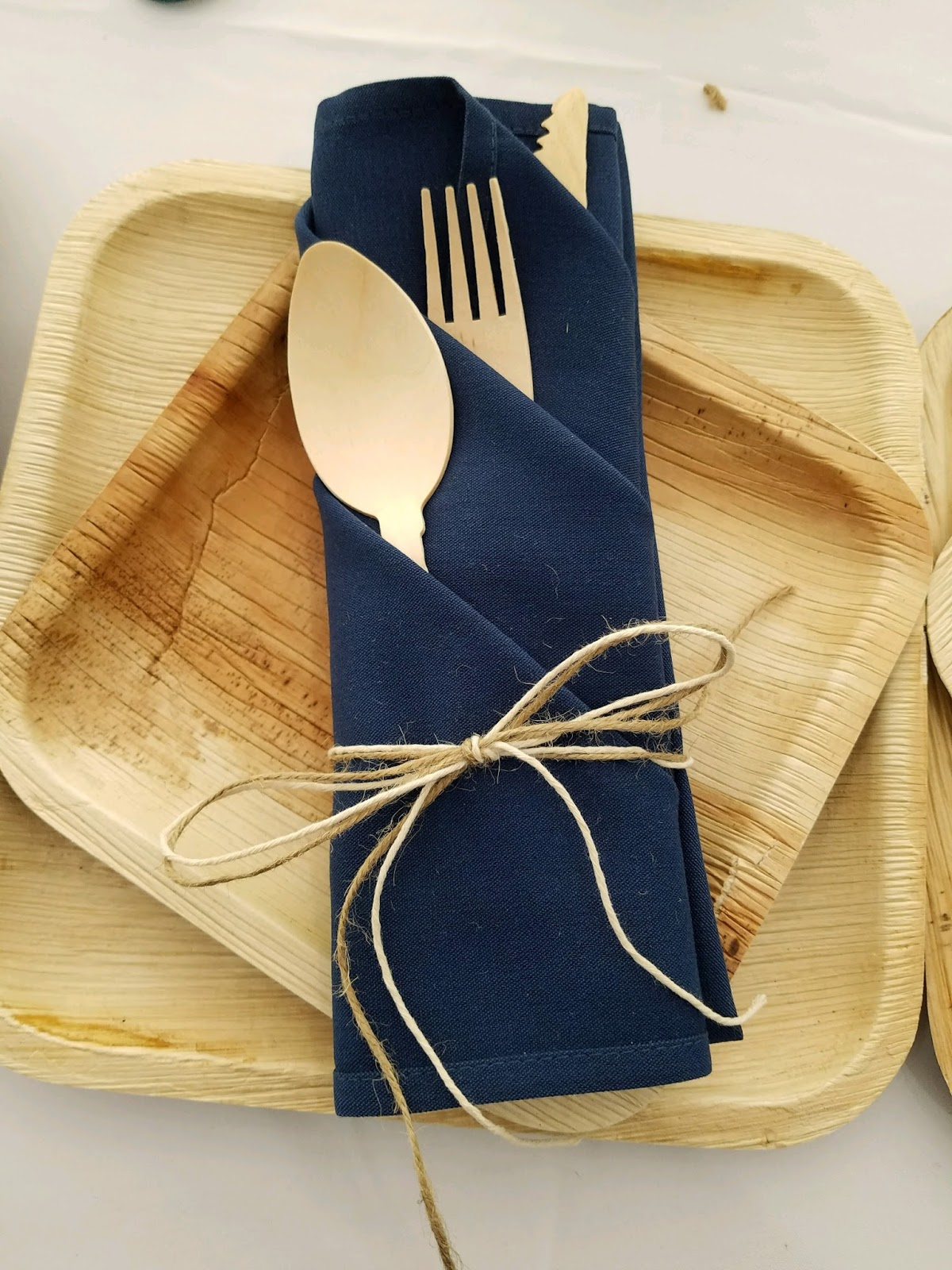 palm leaf wedding plates purchased from webstaurantstore.com and wooden utensils from confetti momma party