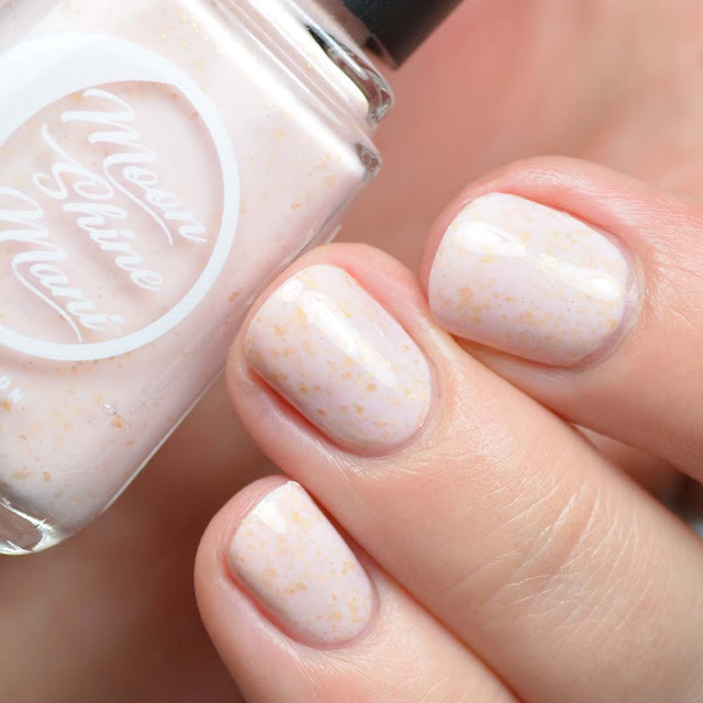 blush nail polish with gold flakies