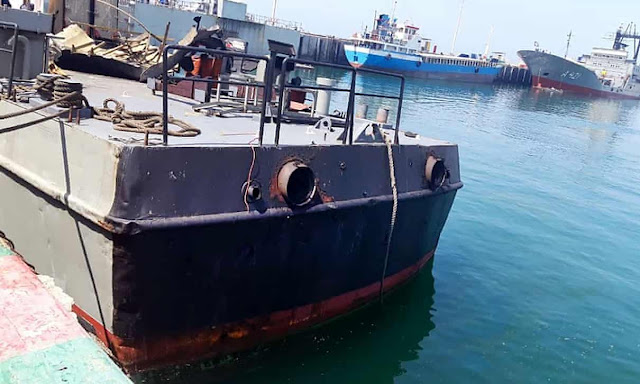 Image Attribute: A handout picture provided by an Iranian army official website shows the damaged Konarak vessel docked at the Jask port in Hormozgan province. / Source: IRNA