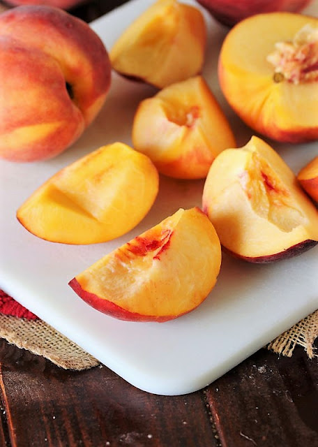 Fresh Peach Quarters on Cutting Board Image