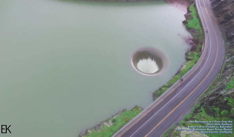 Man Notices Massive Hole In Lake, Flies His Drone Into It And Captures Incredible Footage