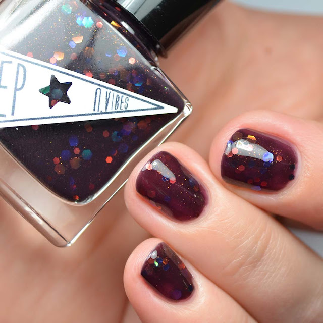 oxblood nail polish with iridescent glitter