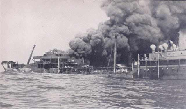 Esso Boston sinking after being torpedoed on 12 April 1942.