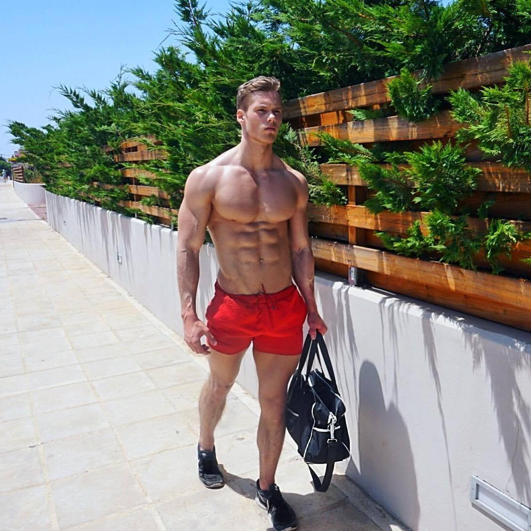 spotted-young-muscular-street-walker-dude-ripped-sixpack-abs-red-shorts