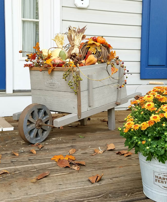 Fall decor in the porch with the bounty of the season
