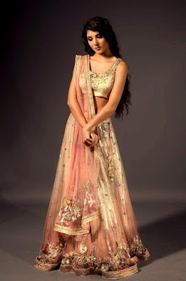 Beautiful Indian Model Girl In Golden Pink Mehndi And Sangeet Lehenga.