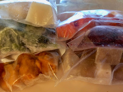 Frozen baby food puree in labeled freezer bags.