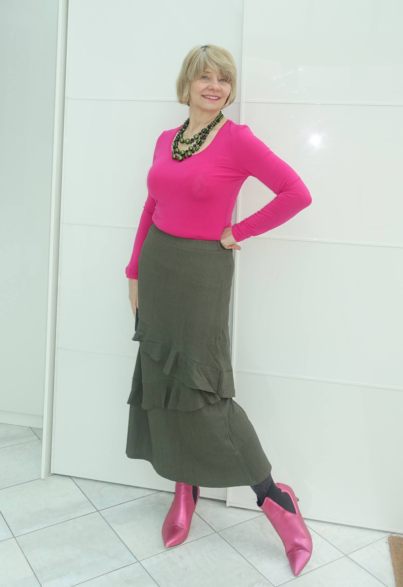 A Covid forgiving waistline and tiers make this khaki skirt a winner for all ages and fuchsia pink means anyone wearing it over 50 will be far from invisible