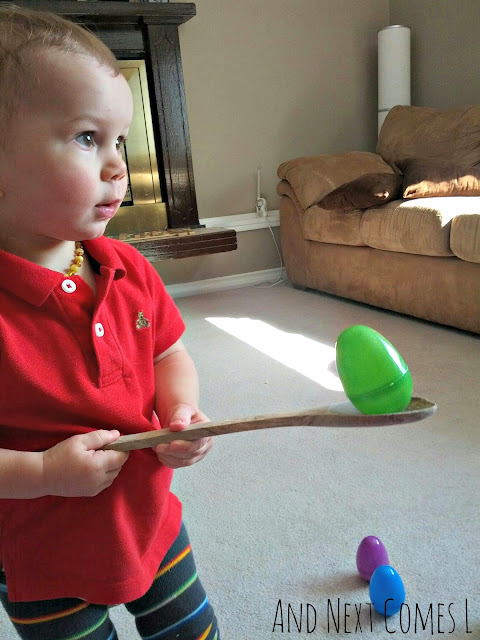 K balancing wobbly Easter eggs on a spoon from And Next Comes L