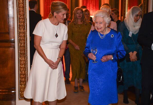The Queen and Countess of Wessex hosted a reception Emilia Wickstead wool midi skirt, Victoria Beckham top, gold necklace