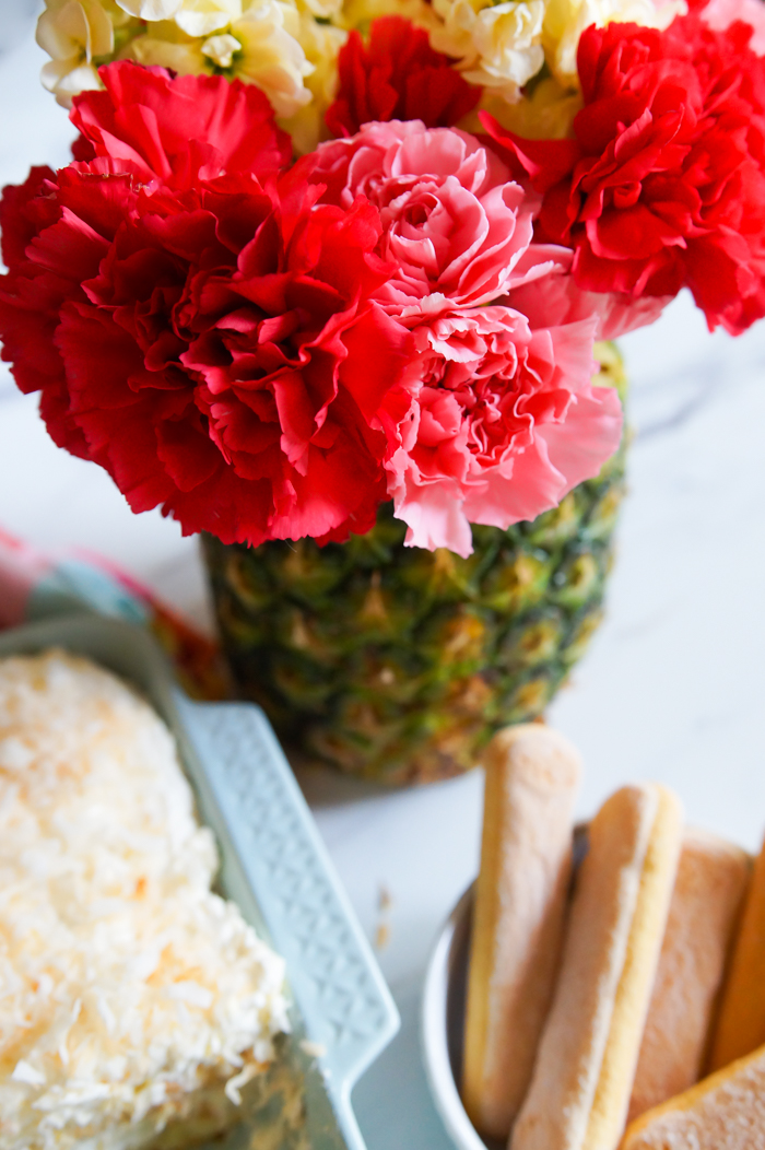 fresh pineapple vase with carnations