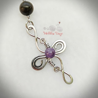 Wire Wrapped Cross with Amethyst Close Up