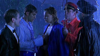 Bride of Chucky horror movie still featuring Gordon Michael Woolvett, Nick Stabile, Katherine Heigl, John Ritter, and Lawrence Dane in the rain