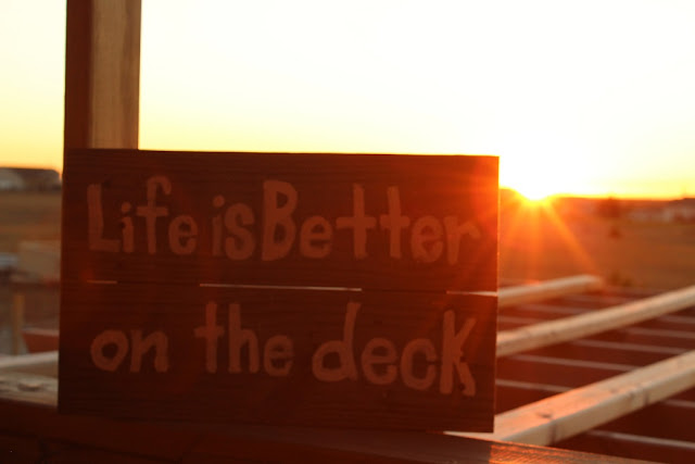 Pallet sign with sunset behind
