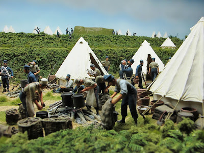 Diorama of 19th-century soldiers at an encampment.