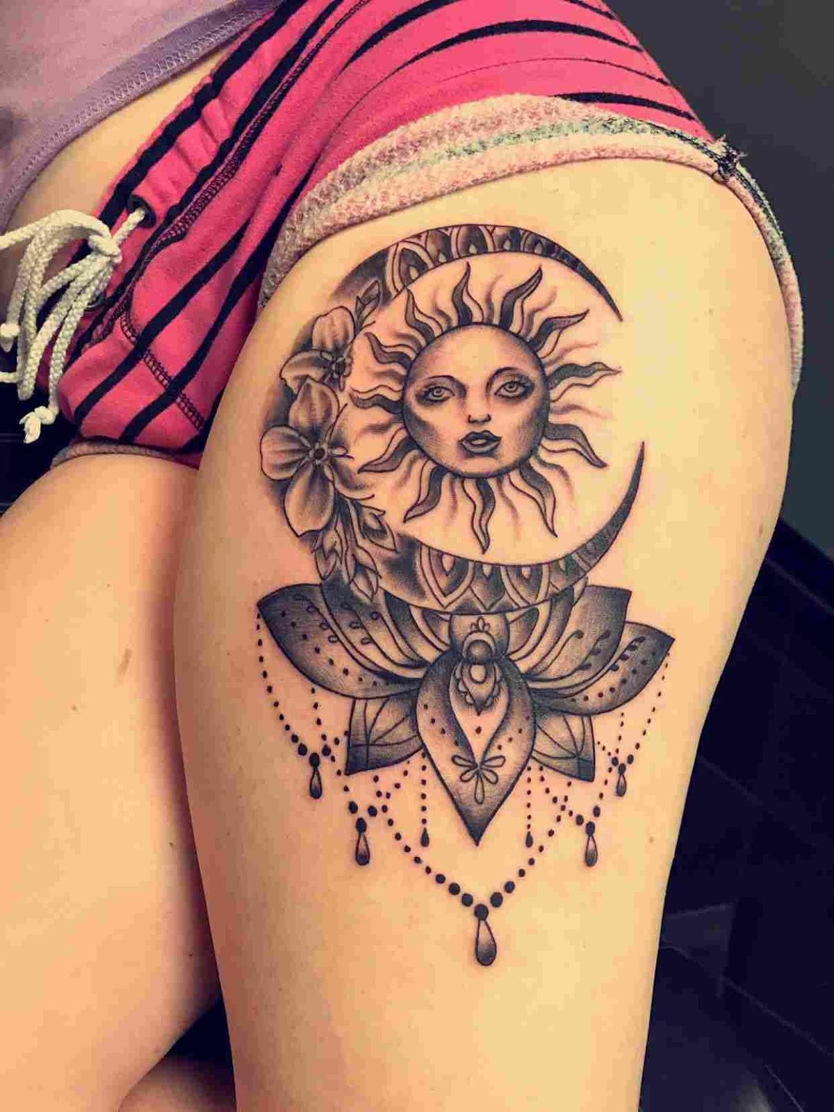 Tatuaje de sol y luna para mujer en la cadera