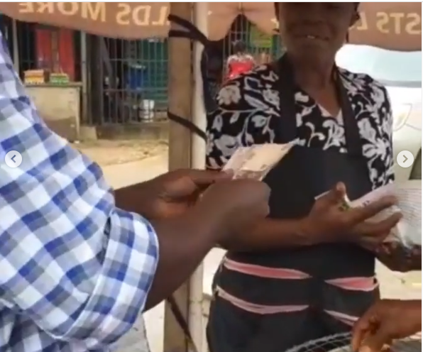 Pastor Adeboye's son, Leke gifts corn seller N10,000 after seeing her pray over her charcoal pot (video)