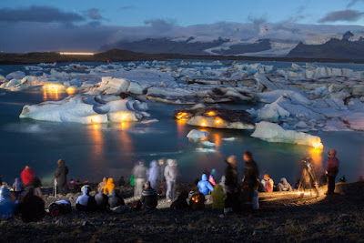 Tourists watching Jökulsárlón glacier lake fireworks display in Iceland in summer