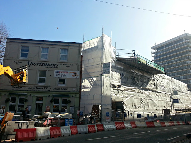 A Bristol pub next to a building under renovation