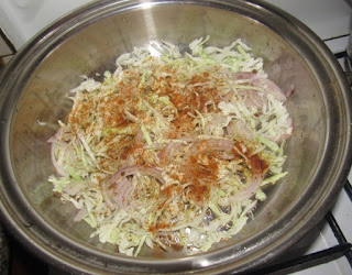 chopped vegetables and seasoning in a pot for making shawarma
