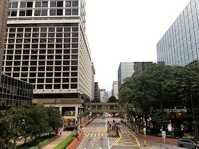 Tsim Sha Tsui East commercial building viewing from footbridge