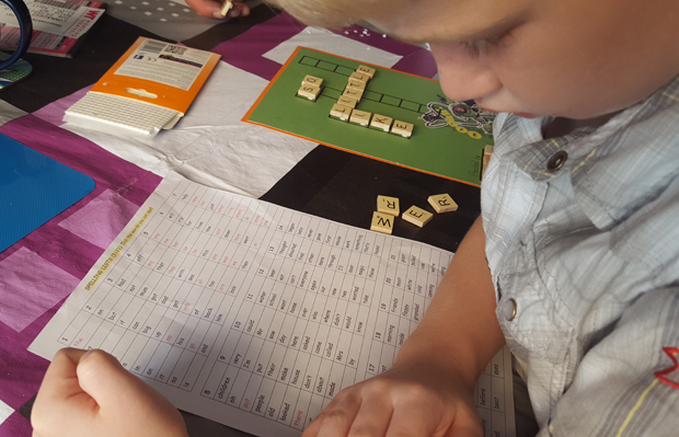 Working out which letters go on his new scrabble card