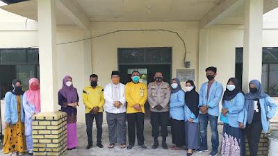 Kapolsek Bandar Seikijang dan Mahasiswa UNRI Sosialisasi COVID-19
