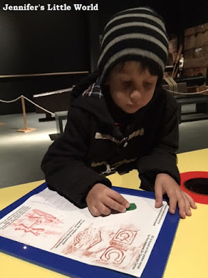 Child doing brass rubbings