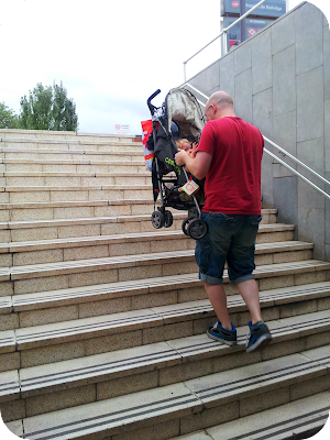 metro with a baby, carrying pushchair up steps